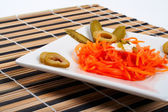 Salad of carrot on a porcelain plate — Stock Photo