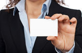 Holding one blank card — Stock Photo