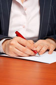 Business woman writing a contract — Stock Photo