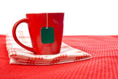 Red cup with tea-bag — Stockfoto