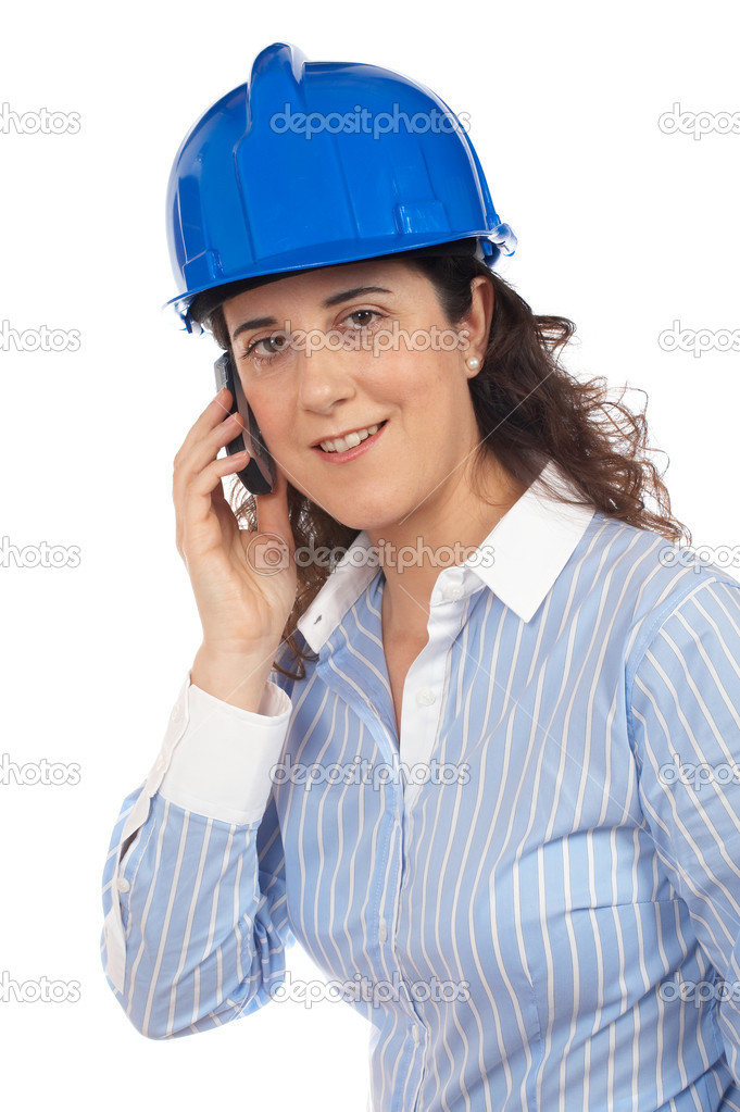 A smiling female architect talking with phone — Stock Photo #5880372