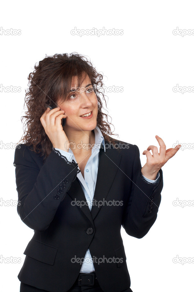 Smiling business woman talking with phone, over a white background  Stock Photo #5880752