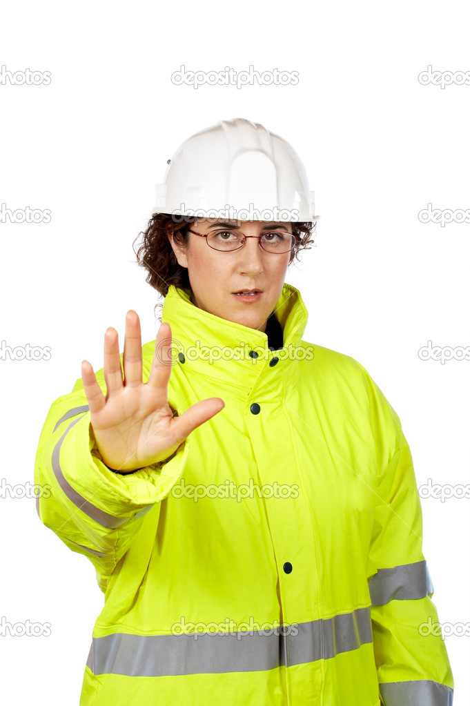 Serious female construction worker saying stop, over a white background. Eyes on focus — Stock Photo #5880813