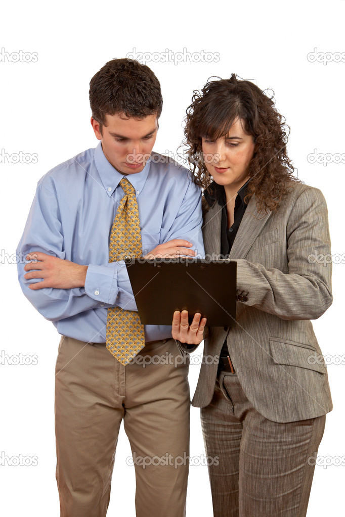Businessman and businesswoman reading a dossier over a white background  Stock Photo #5881062