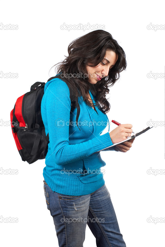 Young student woman with a black backpack  writing on white background — Stock Photo #5881197