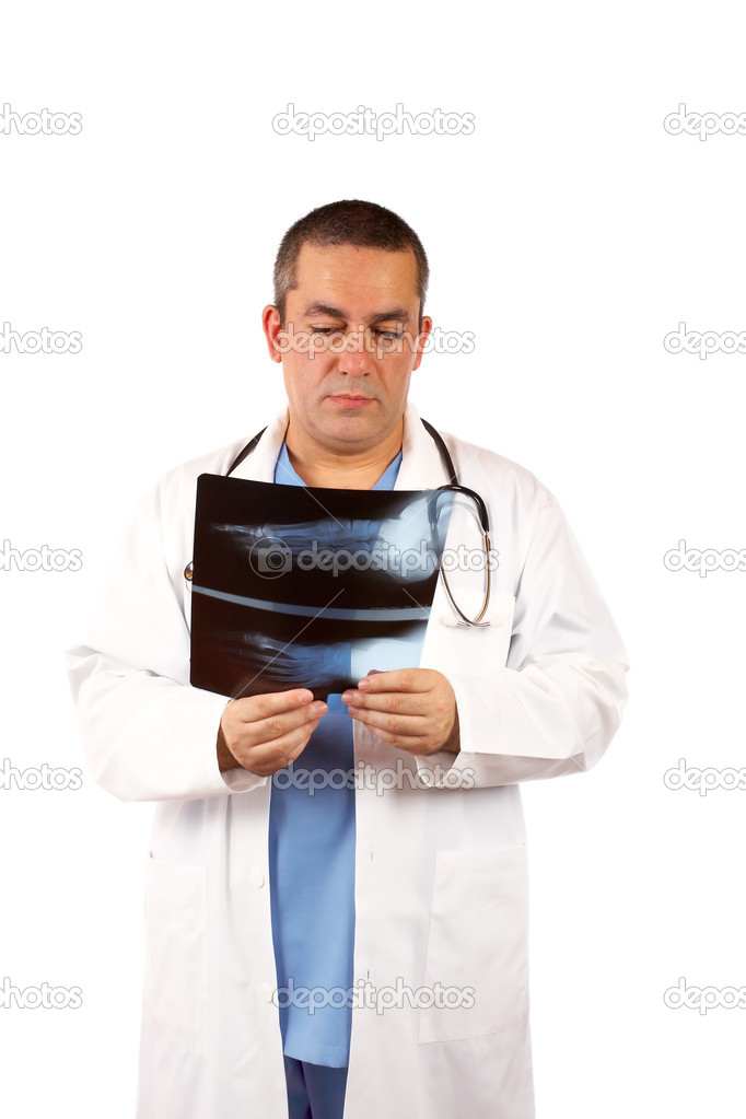 Friendly male doctor in lab coat, examining x-ray against white background — Stock Photo #5881502