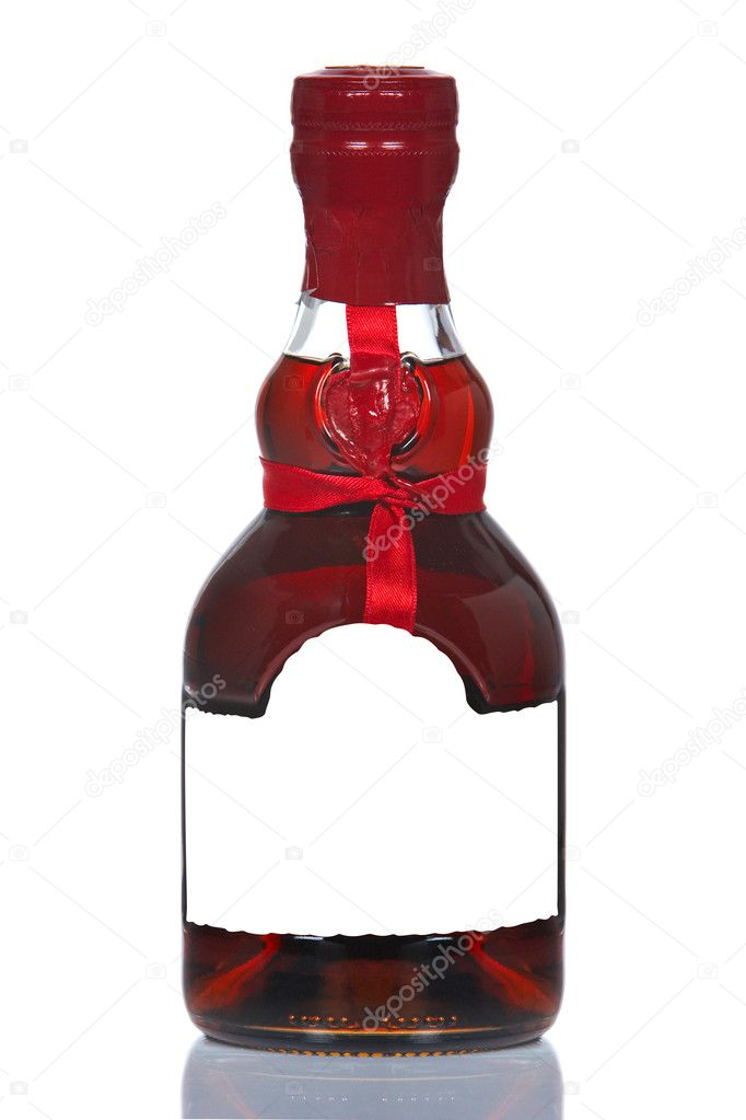 A vintage cognac bottle, reflected on white background — Stock Photo #5881659