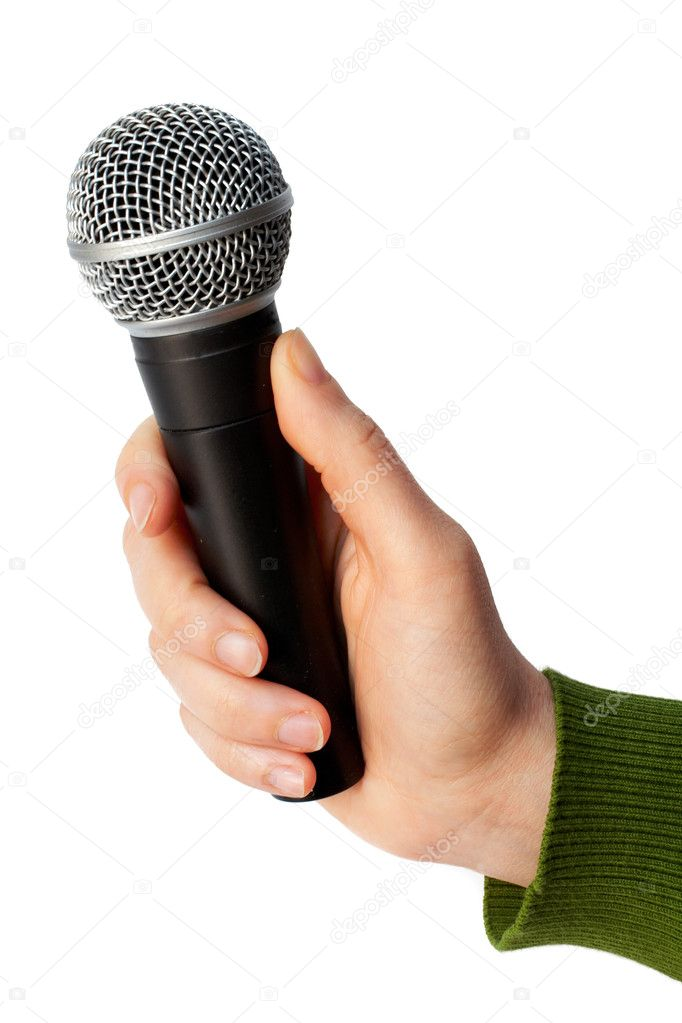 Holding a microphone — Stock Photo #5882578
