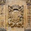 Carved stone coat of arms - Stock Photo