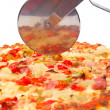 Italian pizza and cutter — Stockfoto