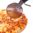 Italian pizza and cutter — ストック写真