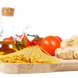 Tomatoes, olive oil, garlic and spaghetti — Stock Photo
