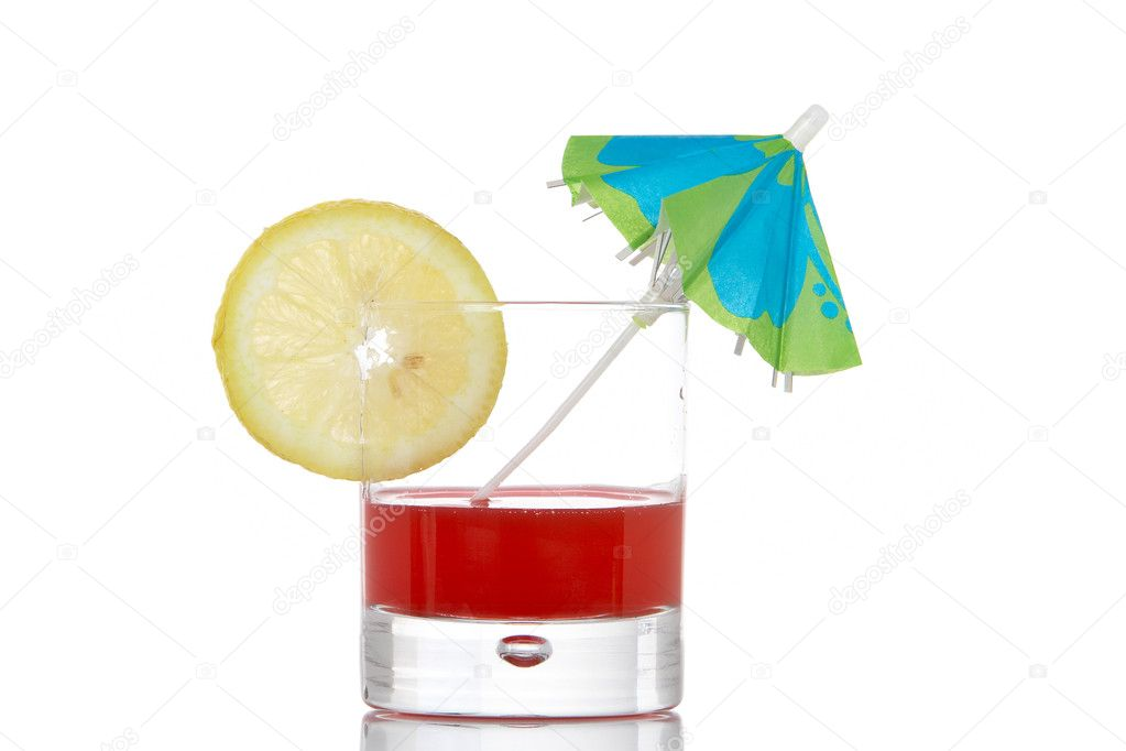 A glass of red juice with a lemon slice and umbrella, reflected on white background  Stock Photo #6339972