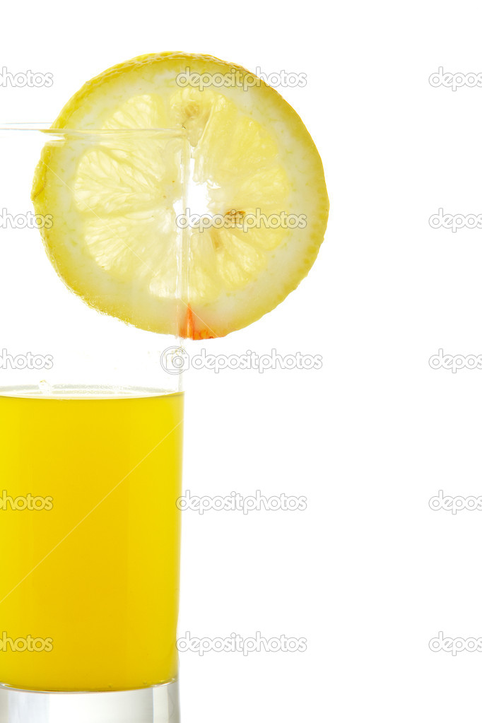 A glass of orange juice with a lemon slice , isolated on white background  Stock Photo #6339999