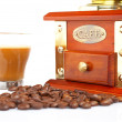Cup, grinder, coffee pot and beans — Stock Photo