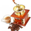 Cup, grinder, coffee pot and beans - Stock Photo