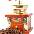 Vintage grinder and coffee beans — Stock Photo