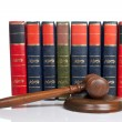 Wooden gavel and old law books — Stock Photo #6340791