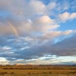 Rainbow over the hill — Stock Photo