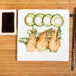 Plate of prawns with soy sauce — Stock Photo #6341081