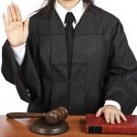 Female judge taking oath — Stock Photo