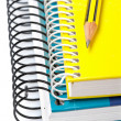 Stock Photo: Pencil on two notebooks