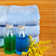 Stock Photo: Towels and soap bottles