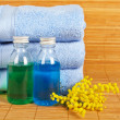 Towels and soap bottles — Stock Photo
