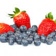 Blueberries and fresh tasty strawberries — Stock Photo