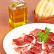 Slices of spanish ham - Stock Photo