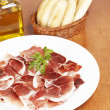 Slices of spanish ham — Stock Photo