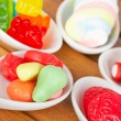 Candies in the spoons — Stock Photo #6345207