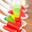 Candies in the spoons — Stock Photo