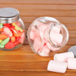 Stock Photo: Colorful candies and pink marshmallows
