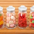 Glass jars of candies - Stock Photo