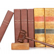 Wooden gavel and old law books — Stock Photo
