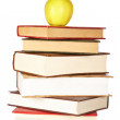 Yellow apple on pile of books — Stock Photo #6345331