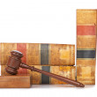 Wooden gavel and old law books — Stock Photo #6345338