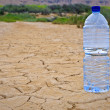 Water bottle on dry ground — Stock Photo #6345795