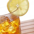 Glass of ice tea with lemon — Stock Photo