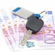 Car key and euro bills — Stock Photo
