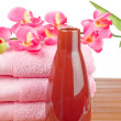 Towels and soap bottle — Stock Photo