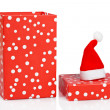 Gift box with christmas hat — Stock Photo #6346219