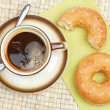 Delicious donuts  with coffee — Stock Photo