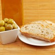 Bread, olive oil bottle and olives — Stock Photo