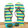 Flipflops on the sand - Stock Photo