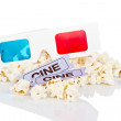 3-D anaglyph glasses, popcorn and two tickets — Stock Photo