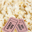 Two tickets on popcorn background — Stock Photo #6347152