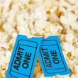 Two tickets on popcorn background — Stock Photo #6347155
