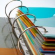 Foto de Stock  : Binder closeup with files stacked